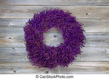 Lavender Wreath on aged cedar wood - Top view angled shot of...