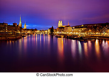 Zurich skyline and the Limmat river at night - view on...