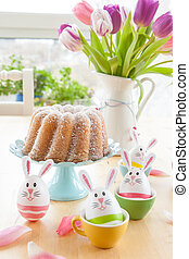 Colorful decorated easter eggs and fresh tulips in vintage...