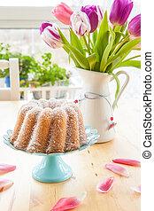 Sponge cake and tulips - Sponge cake in gugelhupf shape and...