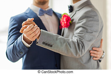 close up of happy male gay couple dancing - people,...