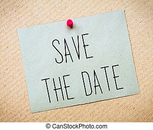 Recycled paper note pinned on cork board.Save the Date...