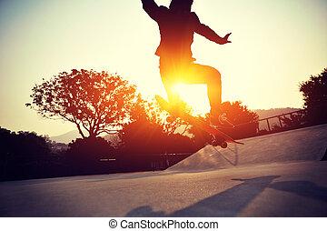 young skateboarder skateboarding - young skateboarder legs...