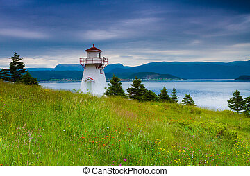 Lighthouse - White lighthouse on the coast of Newfoundland,...
