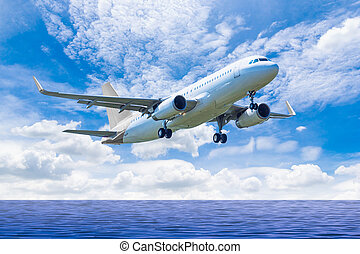 air plane flying on the sea