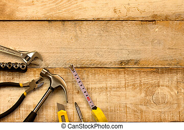 work tools - Assorted work tools on wooden background
