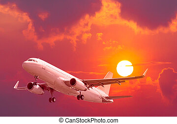 air plane flying with sunset