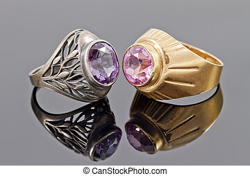 Two old ring from gold and silver with precious stones