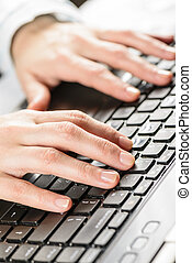 Female hands typing on laptop. - Close-up of woman hands...