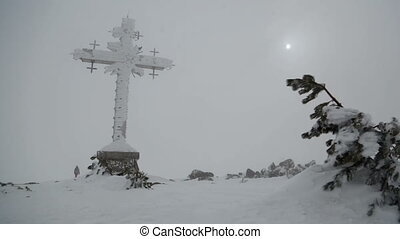 Giant cross. - Mountain panorama with a giant cross.