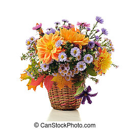 bouquet of autumn flowers in basket isolated on white
