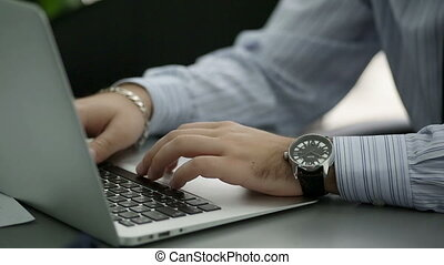 Man is typing on laptop keyboard Shallow depth of field -...