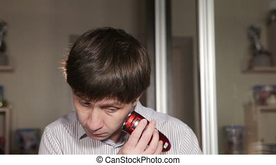 Shaving mustache - Young man shaves off his mustache...