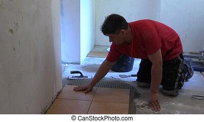 man glue ceramic tile
