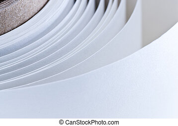 white roll of paper - roll of a white paper background in...