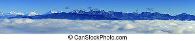 Aerial view on Alps mountains upon clouds, seen from upon...