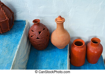 Group of clay jugs on the steps of the house