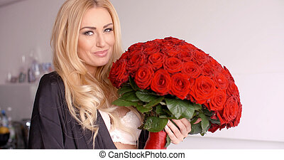 Smiling Woman in Sleepwear Holding a Rose Bouquet - Close up...