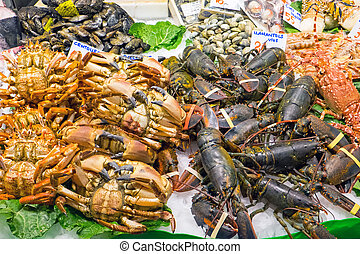Shellfish at the Boqueria market - Shellfish for sale at the...