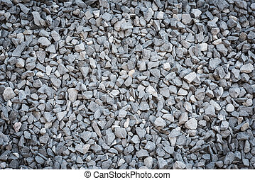 Granite gravel texture - close up grey granite gravel...