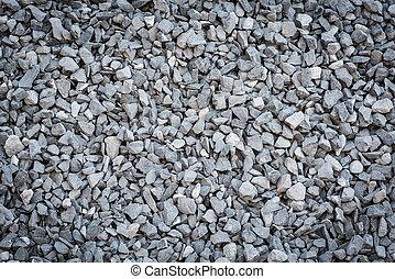 Granite gravel texture - close up grey granite gravel...