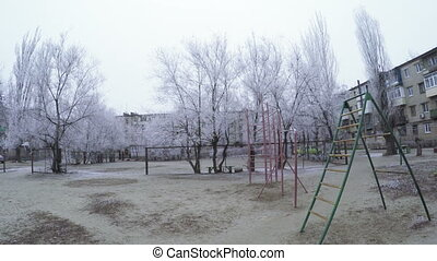 Hoarfrost in city - On trees and playground city frost