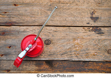Oil can on wooden background, Lube oil can and used in...