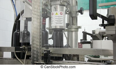 The automatic machine for packing of bottles with wine on a...