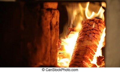 Firewood burns in a bright flame of fire