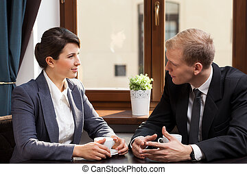 Business appointment in coffeehouse - Office workers having...