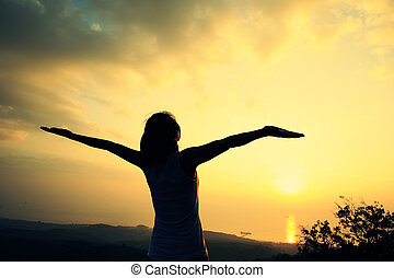 cheering woman open arms mountain - cheering woman open arms...