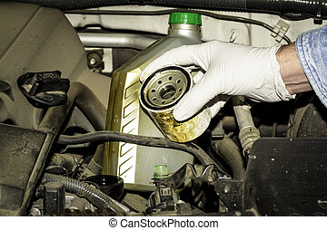 Oil filter and bottle in the engine compartment - Check the...