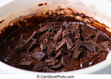 Mixing chocolate chunks in chocolate batter
