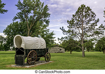 Historic scene with covered wagon and bunk house - Rustic...