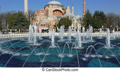fountain with Hagia Sophia - crowd visiting Hagia Sophia at...