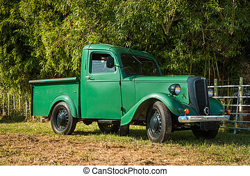 Vintage Green Truck - Green vintage small truck park under...