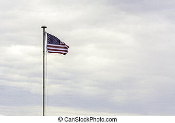 Red White and blue American flag and sky