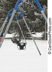 Swingset in cold2 - Swing set seat in cold weather with snow...