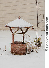 wishing well - Wooden wishing well in snowy winter scene