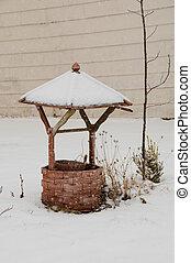 wishing well - Wooden wishing well in snowy winter scene