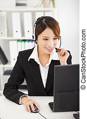 young  businesswoman with headset working in office