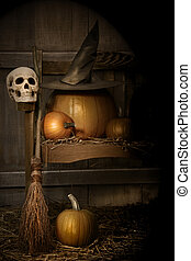 Big pumpkin with black witch hat and broom