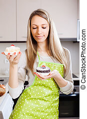 Blonde girl with cakes