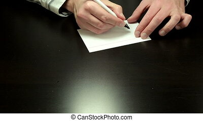 Written note Go Ahead - Man hands write the words Go Ahead...