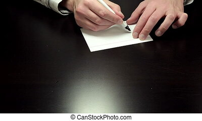 Written note 50 percent - Man hands write the figures 50...