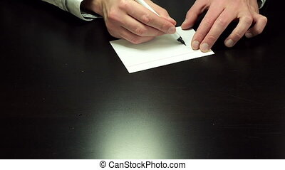 Written note Lose - Man hands write the word Lose on white...