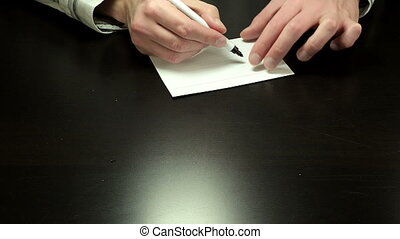 Written note 10 percent - Man hands write the figures 10...