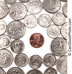 One penny coin among other coins. - Single penny coin among...