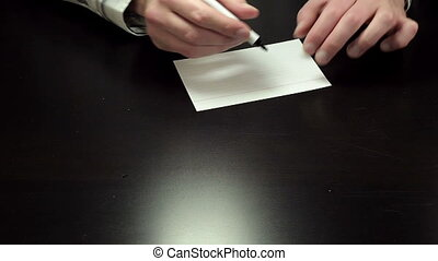 Written note Sale - Man hands write the word Sale on white...