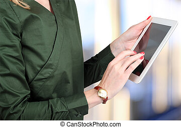 Busineswoman holding and working with a digital tablet